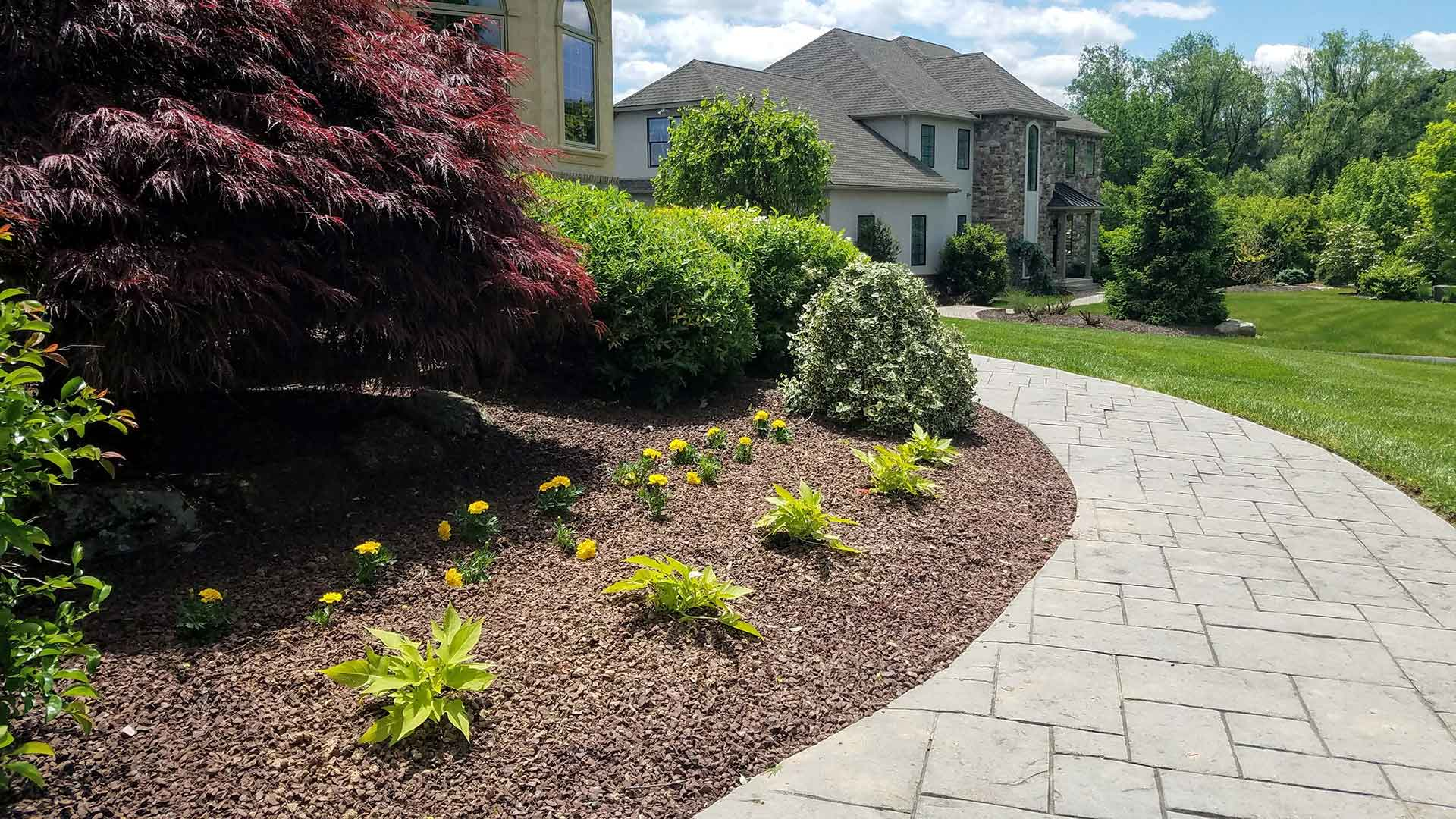 Landscape installation with bed and plantings near Macungie, PA.